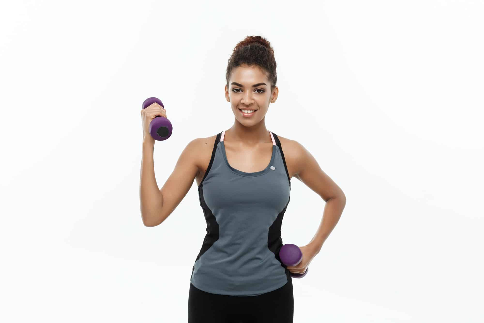 Healthy and Fitness concept - Beautiful American African lady in fitness clothes workout with
